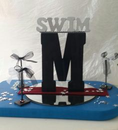 Swim banquet centerpiece with picture holders
