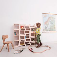 Dutch Designer Reinier de Jong has scaled down his extendable REK Bookcase so it can be used by children to store books and toys.
