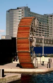"Rolling Bridge, London Forget the drawbridge. In London, the 12m-long Rolling Bridge curls to one side to let boats through the Grand Union Canal at Paddington Basin. ""Its eight steel and timber hinged sections will curl up until the two ends of the bridge meet, forming an octagonal shape,"" said Koen Kas, an entrepreneur from Belgium. ""Every Friday at noon, the bridge performs its acrobatics for admiring crowds."" (Photofusion/Universal Images Group via Getty Images)"