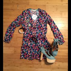 "6 Shore Road 70s Romper This romper is NWT! It has a beautiful multicolored retro checker design. It has a drawstring waist tie and button up closure at top, front. It has slant pockets. It is approximately 29"" from shoulder to bottom of shorts. The bust is approximately 16"" across when laid flat. Waist is approximately 14"" across when laid flat. Waist is not stretchy, but can be adjusted to make smaller. 100% polyester 6 Shore Road Pants Jumpsuits & Rompers"