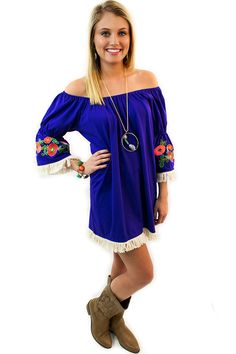 Embroidered Bell Sleeve Dress - $46.95 - This purple Embroidered Bell Sleeve Dress, now available at Envy Boutique, has an elastic neckline, with adorable white fringe all along the bottom hem line as well as on each of the bell sleeves.  An embroidered vine of flowers on each sleeve adds that POP of color that brightens every fantastic dress.   | available at http://www.envyboutique.us/product/embroidered-bell-sleeve-dress/ |  #Envy #Boutique #fashion #fashiontrends