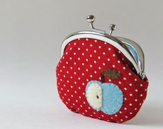 "Apple coin purse  red polka dots by oktak on Etsy, $29.00  A blue apple is appliqued on one side of this kiss lock coin purse.   The base fabric is red with small polka dots, and the lining is solid blue.  It can be used not only as a coin purse but also as a jewelry case.    Dimensions:  Approximately 4"" wide x 3.5"" high (10cm x 9cm) at the widest/tallest part when flattened. Credit cards do NOT fit into the pouch.  The metal frame is 3.25"" wide x 2"" tall (8cm x 5cm)"