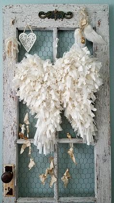 Heavenly Tattered Angel Wings These beautiful fluffy angel wings are made from tattered and torn strips of abandoned vintage fabrics that will bring a soft romance to any room they fly to! A hand formed wire base was made into pretty little wings, painted a creamy white with all