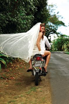 How cool is this! Only in the Cook Islands! Check out our website to boom your scooter for your special day www.polynesianhire.co.ck