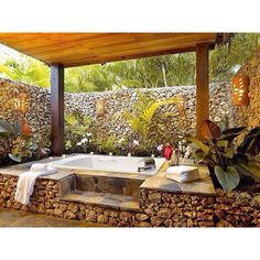 Outdoor bathtub but I like this style for a hot tub.