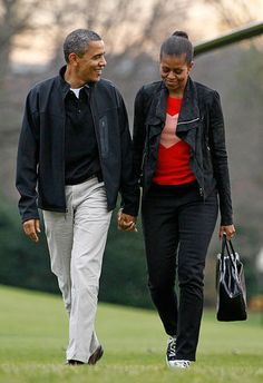 President Barack Obama and the First Lady Michelle Obama cross the South Lawn of the White House in Washington, after attending a college basketball game in Towson, Md.