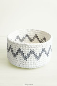 Preview of jakigu's newest crochet pattern: sturdy crochet basket with a minimalist chevron crochet detail. Comment and get an instant 50% off coupon code for this PDF crochet pattern!