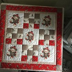 Beverly Adams stitched out this cute quilt! Sock Monkey Applique Too is… Baby Patchwork Quilt, Baby Boy Quilts, Children's Quilts, Amish Quilts, Quilting Projects, Quilting Designs, Quilt Design, Baby Quilt Patterns, Baby Mobile