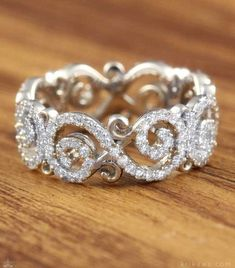 Sparkling Infinity Signs wrap your finger in diamonds! This Carved Infinity Pave Wedding Band is handcrafted in the metal and stones you want!