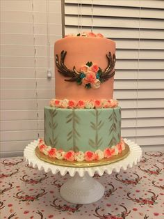 Mint & Coral buttercream tiered baby girl shower cake #antlers #arrows #russianpipingtips #girlhunter