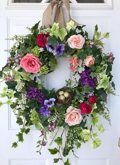 This delightfully colorful spring wreath is a true herald of spring! A potpourri of flowers, including hydrangea, garden roses, pansies, honeysuckle, ranunculus, flowering vines and viburnum combine to make a lovely spring garden display. Natural looking foliages, including garden ivy,