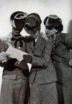 The Classic Tailored Suit - 1940 Edition.. During the war years women's roles in their nation's were part of the war effort. Fashion was sensible and somewhat masculine.  The colors were drabe, and women still made a lot of their own clothing