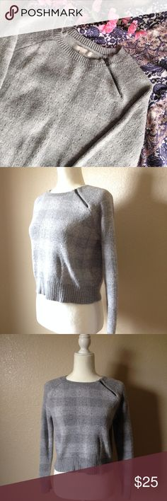 "Banana Republic Shoulder Zip Cropped Sweater Super cute Banana Republic sweater, grey toned checkered pattern. Features slightly cropped silhouette, left shoulder zip detail, crew neck, ribbed trims and small patches of metallic silver thread. Gently used, size S. Approximately 38"" bust, 19.5"" long and 19"" sleeve inseam. I happily entertain reasonable offers 😊🌸 Banana Republic Sweaters Crew & Scoop Necks"