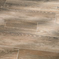 faux wood tile---available  Shop Style Selections Natural Timber Cinnamon Glazed Porcelain Indoor/Outdoor Floor Tile (Common: 8-in x 48-in; Actual: 7.72-in x 47.4-in) at Lowes.com