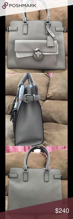 "NWT Authentic Michael Kors Emma Satchel ~*~*NEW WITH TAG MICHAEL KORS EMMA SAFFIANO LEATHER SATCHEL HANDBAG IN Grey~*~*(LARGE)                             ~*~*PRODUCT DETAILS~*~* material - saffiano leather  color - grey  Measures approx 13"" x 11 1/2""  double handle - 4.5"" drop  longer strap - adjustable 18-20"" drop  interior - 1zip pocket,4 open pockets,center zip divider compartment  exterior - 1front pocket with magnetic snap closure  tag attached,dust bag,card included in original…"