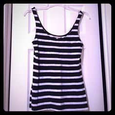 Banana Republic Tank Top Cute black and white stripe tank top. Sequins on the white stripes. Worn but great condition! Size XS Banana Republic Tops Tank Tops