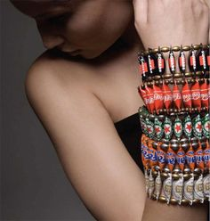 cool bottle cap bracelet, but whats up with the fashion photography. getting a little serious?? are we??