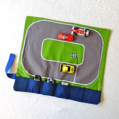 "Kids Stuff: ""DIY Car caddy with a race track. Perfect for keeping kids busy while traveling or at restaurants."" This is cute, but thinking you could make it mess proof & use it as a placemat for restaurants."