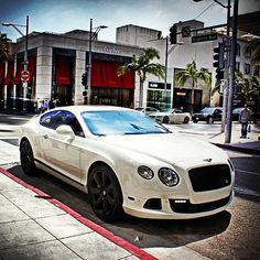 Bentley Continental GT in White with Black Rims. A classy, sporty, fast coupe one of the best luxury sports cars ever made! - gearnova.com
