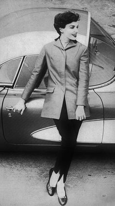 In this wonderful mid-50s B image for Vogue, a golden-brown leather jacket is partnered with brown wool flannel driving pants. #vintage #fashion #1950s #pants #jacket #car