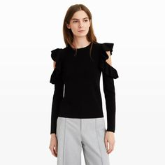 Our striking Colema sweater features allover ribbing for a flattering, slim fit while shoulder cutouts and ruffle details make it a true standout. Pair it with trousers for a more formal look or add a pair of high-waisted jeans and heels for an evening out. Viscose blend Slim fit 22' in length, based on a size M Crew neck; allover ribbing; cutouts at shoulders with ruffle detail      Hand wash Imported