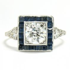 1920's Platinum & Diamond Ring, 0.71ct G-SI1 - This 1920's engagement ring is crafted in platinum and features one 0.71 carat Old European cut diamond rated G color, SI1 clarity. Sapphire accents. -                                                                                        $4,750.00                                      - http://www.excaliburjewelry.com/shop/rings/engagement-rings/1920-s-platinum-diamond-ring-0-71ct-g-si1.html