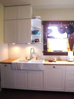 Painted tin ceiling backsplash(these are ikea cabinets btw)