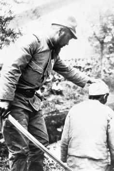 The Second Sino-Japanese War was from 1937 to 1945, as Japan, victorious in the First Sino-Japanese War, started to exert its influence in Chinese areas and tried to unseat China's Nationalist government under Chiang Kai-shek. Here, a Japanese man threatened a Chinese prisoner around 1938.
