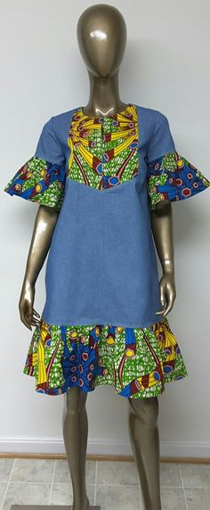 Denim and African Print Shift Mini Dress. This is a beautiful above knee length African Print and denim Shift dress with short bell sleeves, slit open neckline, and side pockets. Short African Dresses, Latest African Fashion Dresses, African Print Dresses, African Prints, African Attire, African Wear, African Women, African Inspired Fashion, African Print Fashion