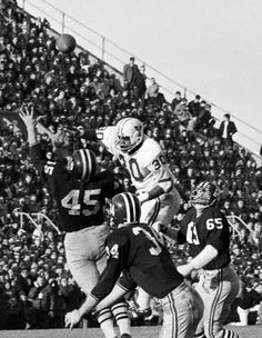 Harvard's Pat Conway (34) attempts to intercept a pass from Yale quarterback Brian Dowling intended for Cal Hill, not shown, as the ball sails over Harvard's Tom Wynne (45) in the second period of their annual college rivalry football game at Harvard Stadium in Cambridge, Mass. With less than a minute left and down 29-13, Harvard scored two quick touchdowns and completed a 2-point conversion on a pass from Frank Champi to Pete Varney to end the game 29-29 Nov. 23, 1968