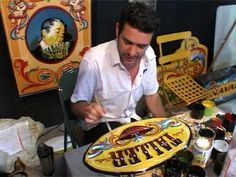 mauricio navarro-fileteado porteño en feriar 2010-córdoba-argentina- tel 0351157668827-taller de fileteado porteño- ventas Paseo de las Artes córdoba capital...