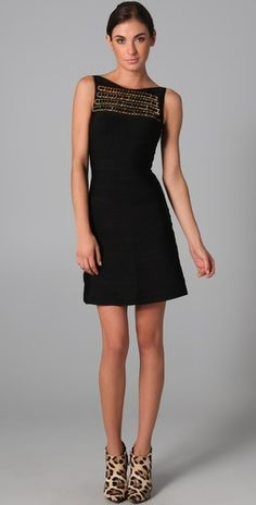 herve leger boat neck dress. love the gold chain detail.