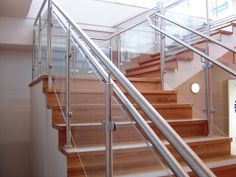 Beautiful stainless, glass and wood stair case by InditalUSA