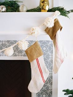 fluffy white pom-pom garland and simple burlap stockings over the fireplace // styling your home for the holidays #christmas #interior #design