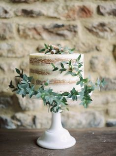 Love this rustic but perfectly edged cake with most delicate foliage...