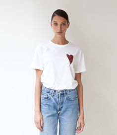 T-shirt Heart 2.0 White by Real Fake  Real Fake whiteoversized T-shirt with heart applique.  The shirt is very soft and can be worn multiple ways.  Show the world that you think and buy with your heart!  Every Real Fake item will include our own Heart Pin. Wear this pin with pride and show the world that you are part of the Fake Revolution.