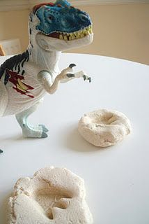 Dinosaur Fossil Prints - showed the preschool teacher this idea.  Super easy and the kids had a lot of fun.