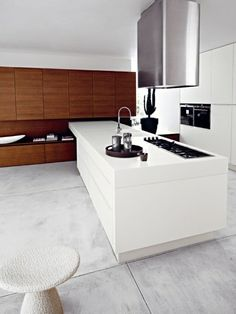 This two-toned kitchen concentrates each color into it's own section, making this kitchen appear larger