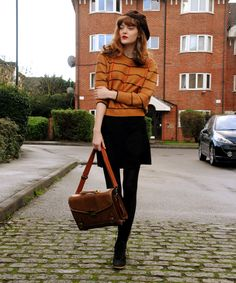 Cosette Munch - a beret and a pumpkin and stripe jumper