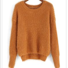 Cozy crop camel long sleeve knit sweater Beautiful fuzzy camel colored sweater. Slightly Loose fit, round neck, fabric has some stretch. 100% acrylic. Bust-39in Length-25.5in Sleeve-24in.  Brand New. Never worn. Urban Outfitters Sweaters Crew & Scoop Necks