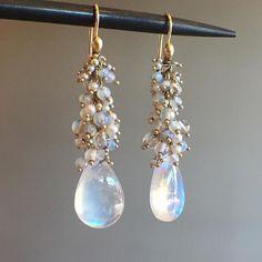 Spectrum moonstones with Opal & seed pearl clusters by Ted Muehling. #moonstone #opal #seedpearl #tedmuehling #oneofakind #jewellery #finejewelry #futureheirlooms #lovegold #augustla