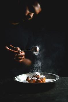 Rice and polenta doughnuts | Food. Art + Style. Photography: Food on black by A Brown Tabl |