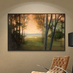 <p>Evoke the tranquility of a stroll through the forest at sunrise with this lovely framed painting print.</p><p>This artful accent offers up a palette of green, yellow and a brown, so it's sure to warm up your room. Made in the USA, it is giclee printed on cotton canvas and highlighted by a clean-lined black frame for museum-worthy appeal.</p><p>Brimming with classic charm, this piece is the perfect finishing touch for your cozy ensemble. Set it ab...