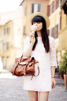I love her long dark hair contrasted with her delicate white dress (realllyyy want my hair to hurry and grow!)