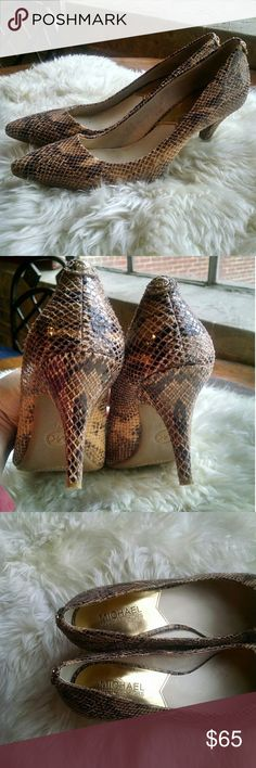 Snakeskin Print Leather Pumps Beautiful MICHAEL Michael Kors snakeskin print leather pumps with a classy pointed toe. Colors are tans, browns, and golds.  Pre-loved. MICHAEL Michael Kors Shoes Heels