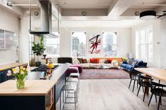 Chic New York City apartment by Casamanara Architects. Love the pops of color
