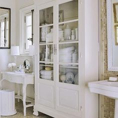 Tall, glass-front bathroom hutch