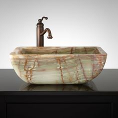 """Sapphira Green Onyx Vessel Sink Sink Material: Onyx Number of Basins: 1 Sink Installation: Vessel Product Color: Green Onyx Faucet Centers: No Faucet Hole Overflow Hole: No Item Weight (lbs.): 64 Length: 19-1/2"""" Width: 13-5/8"""" Height: 6-1/8"""" Basin Length: 18"""" Basin Width: 12-1/8"""" Basin Depth: 4-3/4"""" Drain Size: 1-1/2"""" Exterior Treatment: Smooth Interior Treatment: Smooth"""