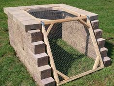 How to Build A Compost Bin. I like the idea of an angled opening. Thinking about constructing the compost bin into a hillside. This is a great long-term compost setup.