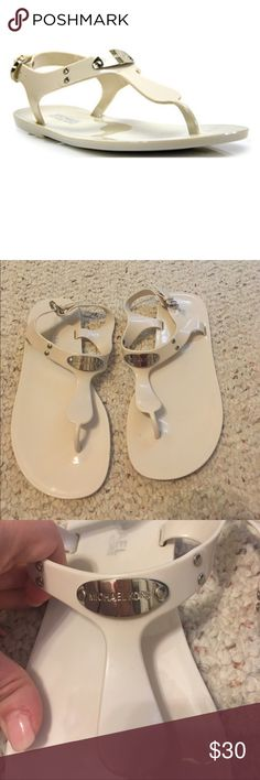 Michael Kors Plate Jelly Sandals Michael Kors plate jelly sandals. Color is called vanilla, it's an off white, cream color. Worn a handful of times. Soles reflect signs of wear. Plate and hardware in great condition. No stains or smudge marks. Michael Kors Shoes Sandals